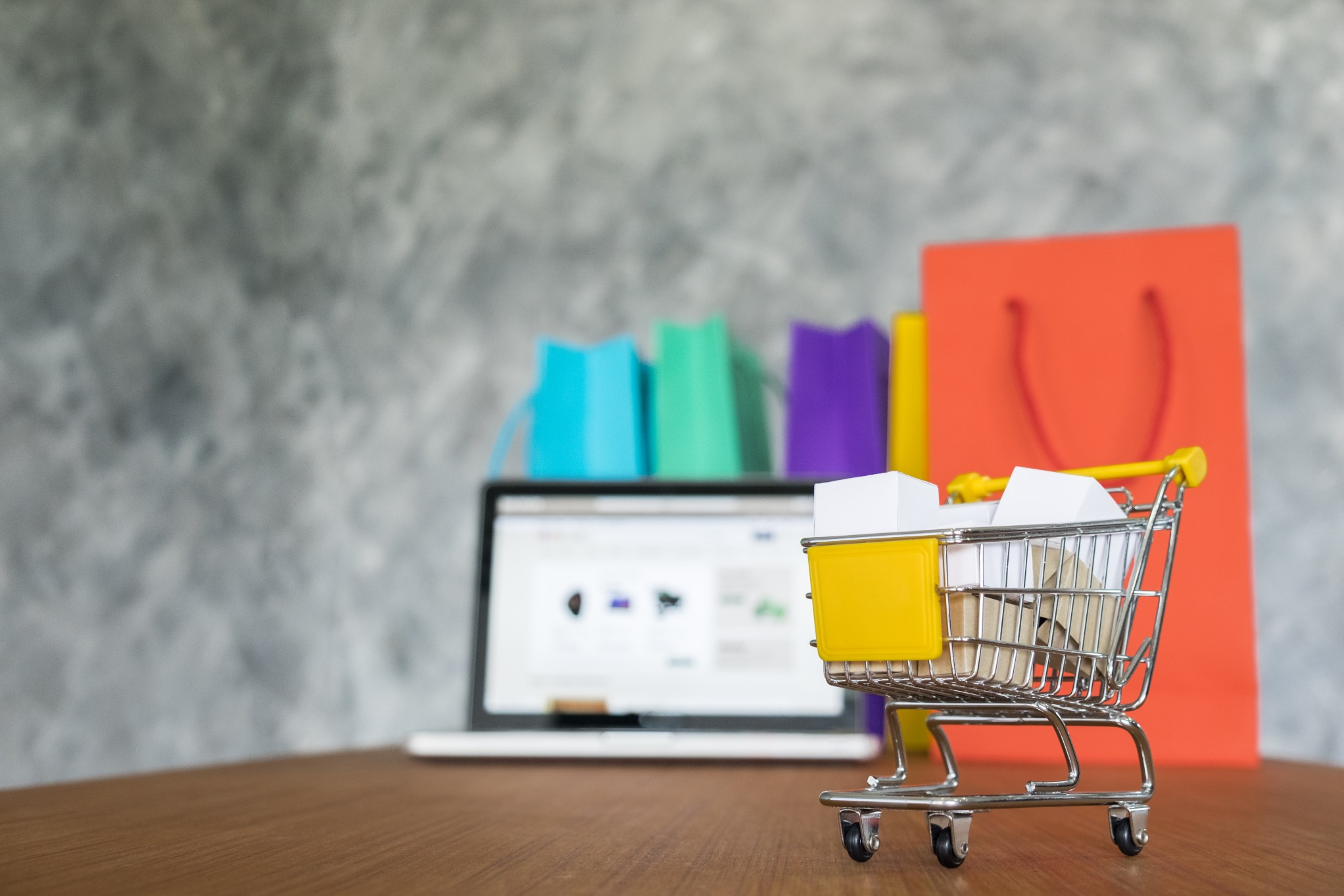 laptop and shopping bags, online shopping concept. customer behavior